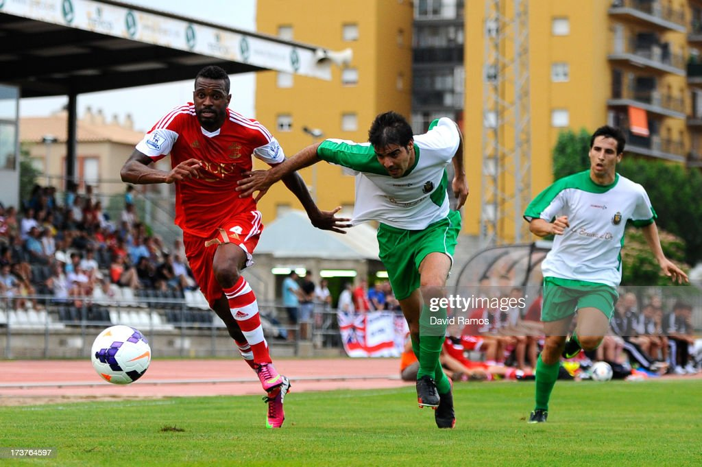 Guly do Prado of Southampton duels for the ball with Enric Pi of UE Llagostera during a friendly match between Southampton FC and UE Llagostera at the Josep Pla i Arbones Stadium on July 17, 2013 in Girona, Spain.