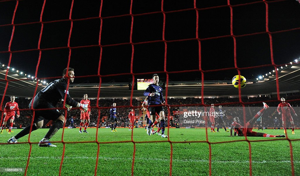 Guly Do Prado of Southampton scores an own goal past Artur Boruc during the Barclays Premier League match between Southampton and Arsenal at St Mary's Stadium on January 01, 2013 in Southampton, England.