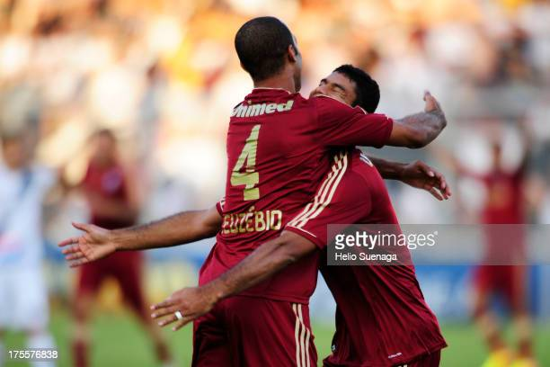Gum and Euzebio of Fluminense celebrate a goal against Ponte Preta during a match between Fluminense and Ponte Preta as part of the Brazilian...