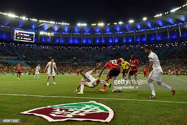 Gum and Rafael Sobis of Fluminense struggles for the ball with Negueba and Andre Santos of Flamengo during a match between Fluminense and Flamengo as...