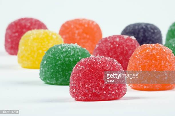 gum drops - sweet candy macro on a white background - gum drop stock photos and pictures