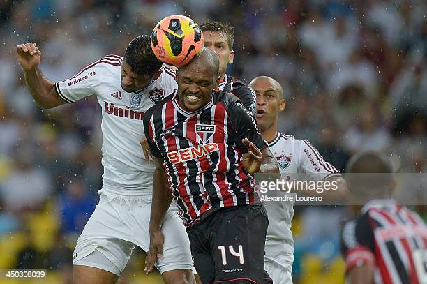 Gum of Fluminense fights for the ball with Edson Silva of Sao Paulo during the match between Fluminense and Nautico for the Brazilian Series A 2013...