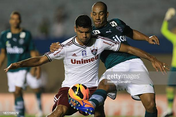 Gum of Fluminense fights for the ball with Rodrigo of Goias during the match between Goias and Fluminense for the Brazilian Series A 2013 at Serra...