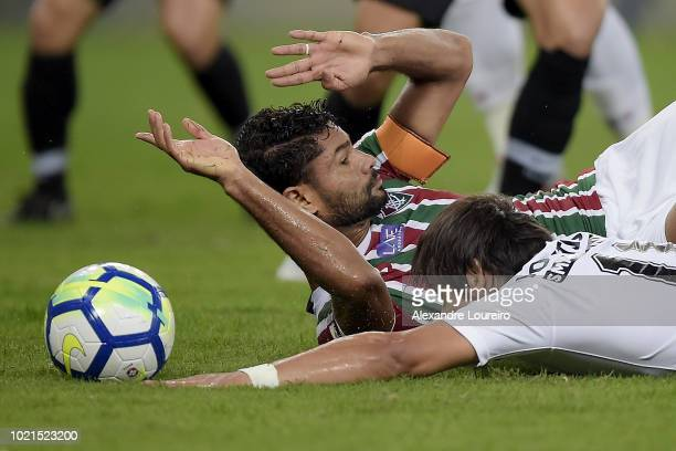 Gum of Fluminense struggles for the ball with Angel Romero of Corinthians during the match between Fluminense and Corinthians as part of Brasileirao...