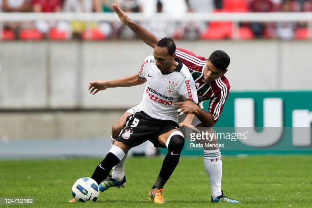 Gum of Fluminense struggles for the ball with Liedson of Corinthians during a match as part of Serie A 2011 at Engenhao stadium on September 11, 2011...