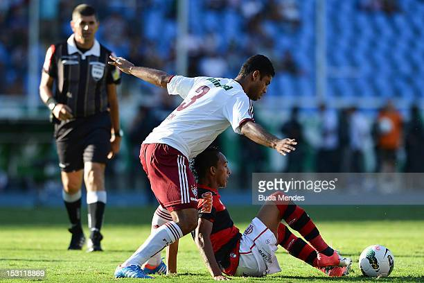 September 30: Gum of Fluminense struggles for the ball with Liedson of Flamengo during a match as part of Serie A 2012 at Engenhao stadium on...