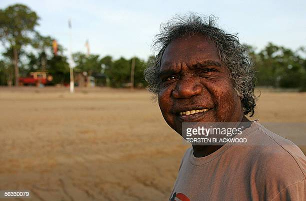 Gumatj Aboriginal elder and lead singer for the Australian band Yothu Yindi , Mandawuy Yunupingu, watches the sun set over Drimmie Head in Arnhem...