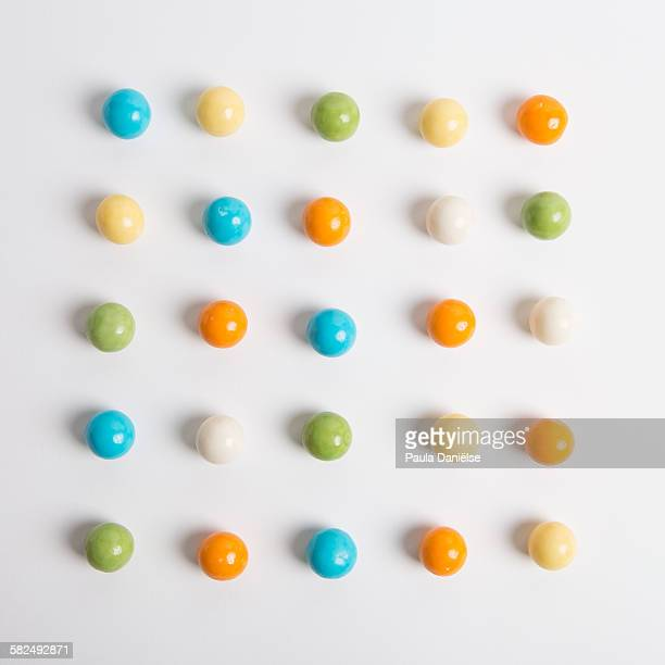 gumball grid - gumball machine stock pictures, royalty-free photos & images