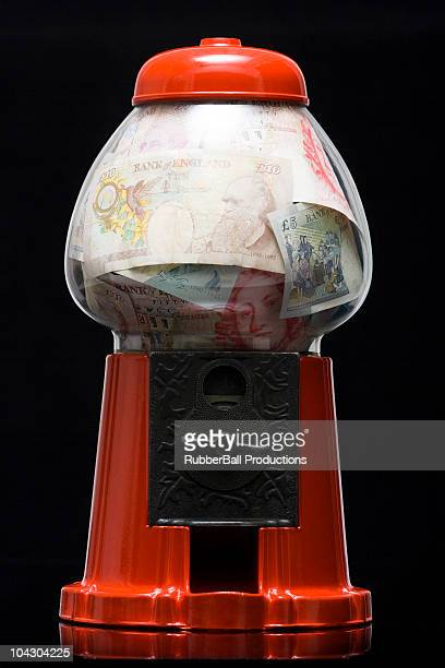gumball machine full of money - fifty pound note stock photos and pictures
