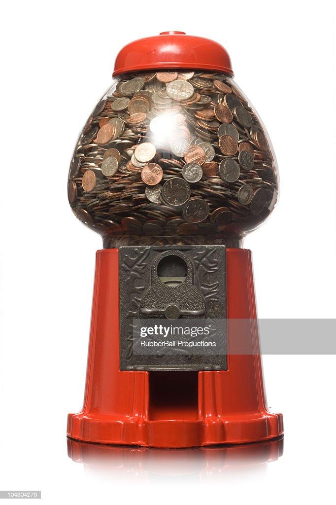 gumball machine full of money : Stock Photo