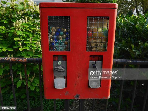gumball machine on railing - gumball machine stock pictures, royalty-free photos & images