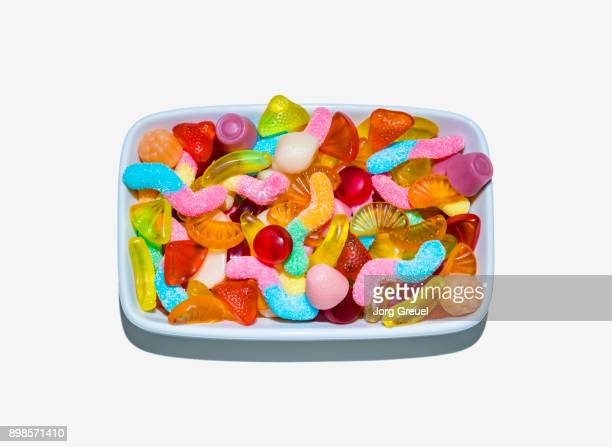 gummi candy - pile of candy stock photos and pictures