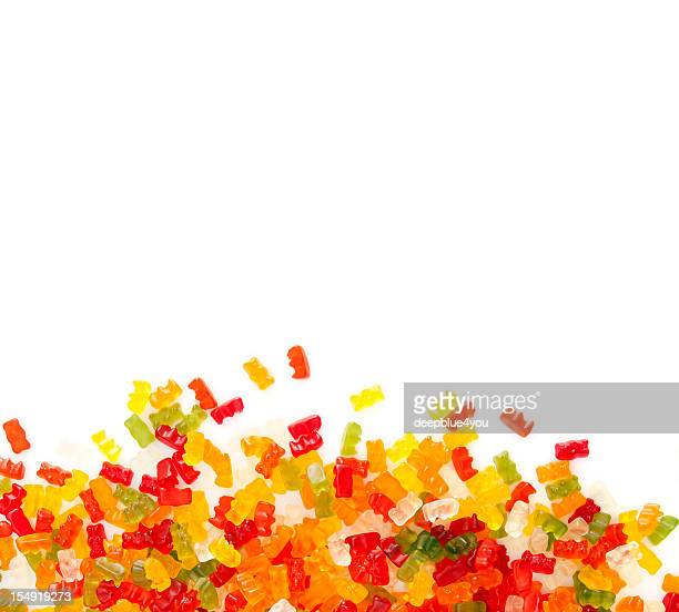 gummibears on white background - gummi bears stock photos and pictures