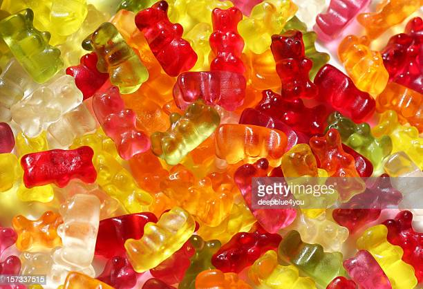 gummy bears background - gummi bears stock photos and pictures