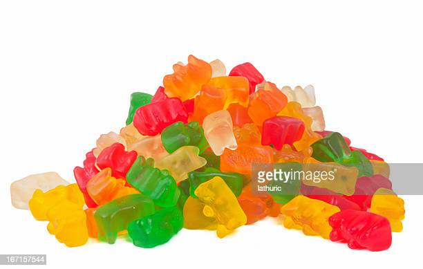 gummy bears stack - gummi bears stock photos and pictures