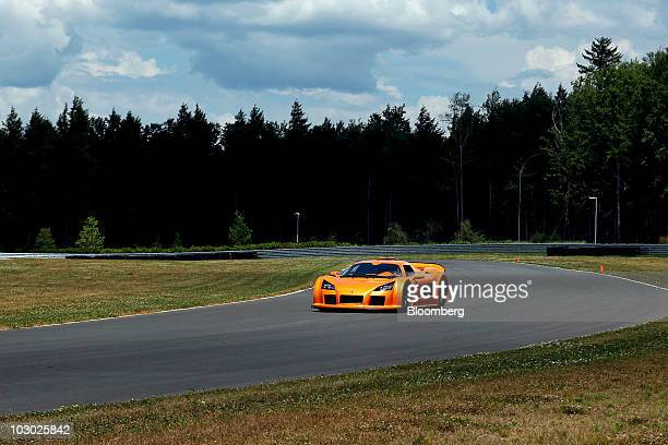Gumpert Apollo supercar is driven on the track at Monticello Motor Club in Monticello, New York, U.S., on Sunday, July 11, 2010. The Apollo base...
