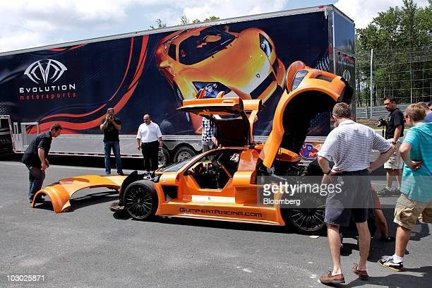 Gumpert Apollo supercar is serviced after being damaged by a driver on the track at Monticello Motor Club in Monticello, New York, U.S., on Sunday,...