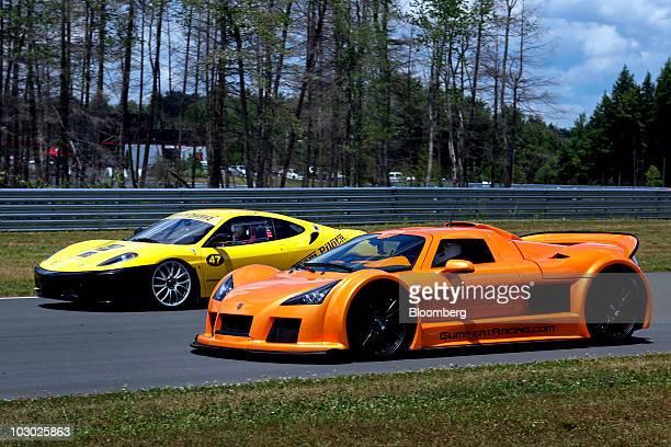 Gumpert Apollo supercar, right, drives next to a Ferrari 430 Scuderia on the track at Monticello Motor Club in Monticello, New York, U.S., on Sunday,...