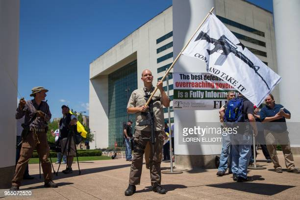 Gun advocate James Singer takes part in a counterprotest in response to protesters opposing the NRA's annual convention on Saturday May 5 2018 in...