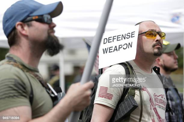 Gun advocates are pictured in front of the Washington state capitol during the March for Our Rights progun rally in Olympia Washington on April 21...