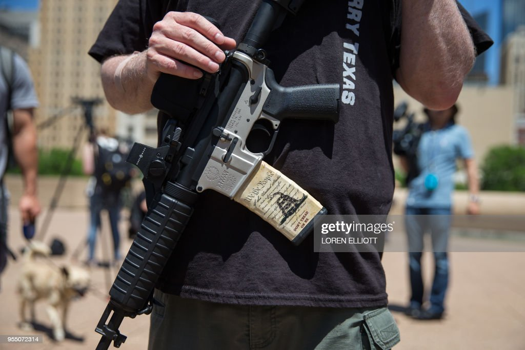 Gun advocates stage a counter-protest in response to protesters opposing the NRA's annual convention on Saturday, May 5, 2018 in Dallas, Texas.