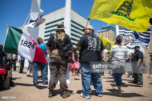 Gun advocates stage a counterprotest in response to protesters opposing the NRA's annual convention on Saturday May 5 2018 in Dallas Texas