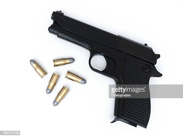 gun and bullets - handgun stock pictures, royalty-free photos & images