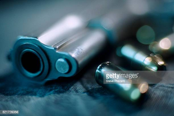 gun and bullets - weaponry stock pictures, royalty-free photos & images