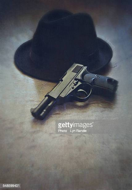 Gun and trilby