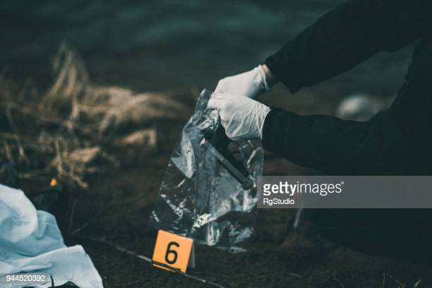 a gun as evidence number six - criminal investigation stock pictures, royalty-free photos & images