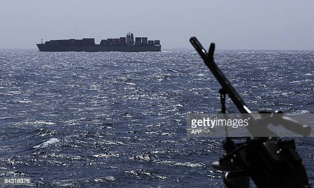 A gun barrel of French Frigate le Floréal is seen as the vessel sails past another ship in the Gulf of Aden on january 16 2009 The EU mission...