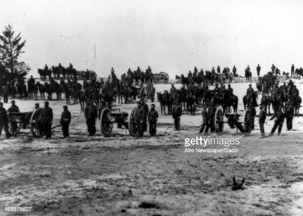 A Gun Battery with arms and men lined up for a drill before going into battle with the confederate army during the American Civil War Photograph by...
