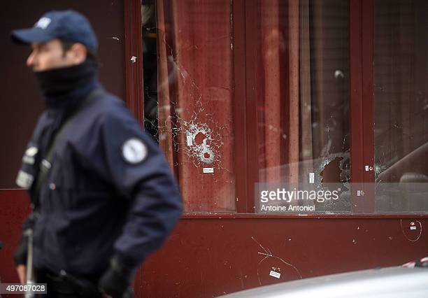 Gun bullet impacts are seen on the windows of Le Carillon bar, the day after a deadly attack on November 14, 2015 in Paris, France. At least 120...
