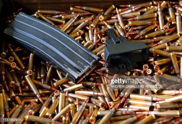 A gun clip is seen in a box of ammunition at a machine gun rental stand during the Knob Creek Machine Gun Shoot and Military Gun show in Bullitt...