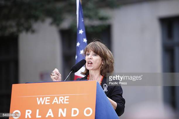 Gun control activist Leah Gunn Barrett speaks NY governor Andrew Cuomo NYC mayor Bill de Blasio appeared together on Christopher Street in front of...