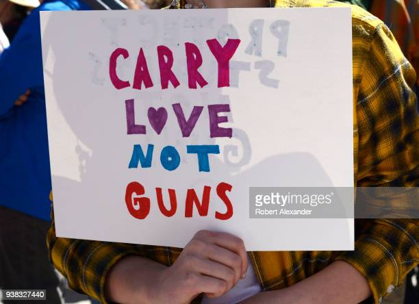 A gun control advocate holds a handmade sign at a 'March For Our Lives' rally in Santa Fe New Mexico The rally and march part of a nationwide series...