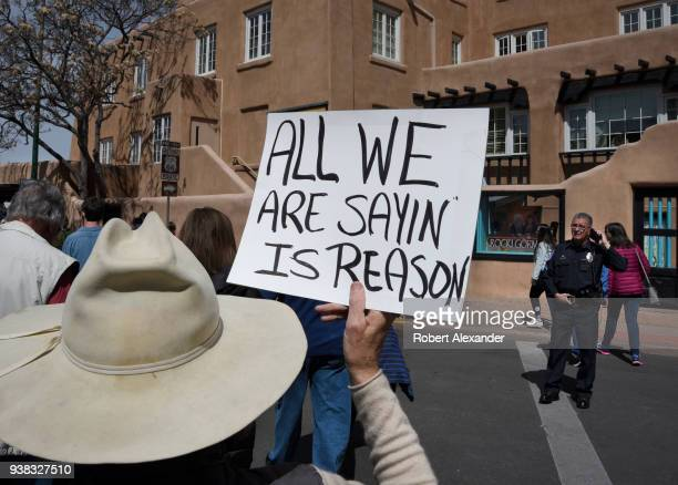 Gun control advocate holds a handmade sign at a 'March For Our Lives' rally in Santa Fe, New Mexico. The rally and march, part of a nationwide series...