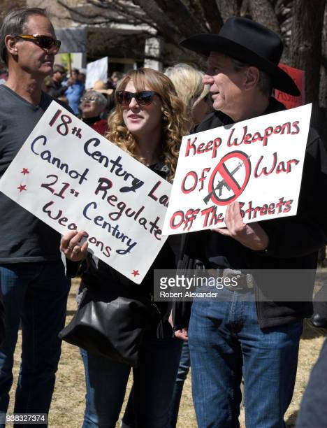 Gun control advocates hold handmade signs at a 'March For Our Lives' rally in Santa Fe, New Mexico. The rally and march, part of a nationwide series...
