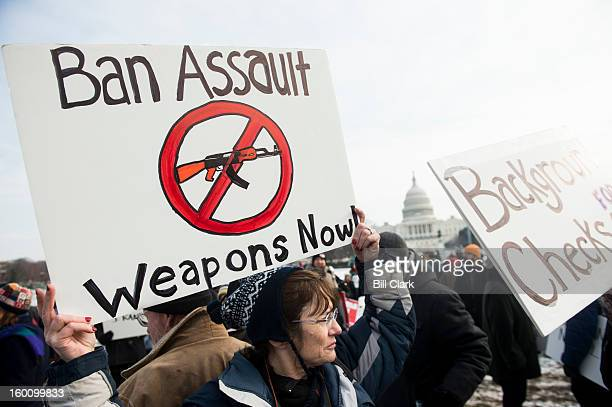 Gun control supporters march from the US Capitol to the Washington Monument to call on Congress to pass gun control measures on January 26 2013 in...