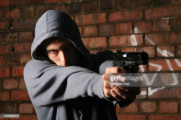 gun crime - armed robbery stock photos and pictures