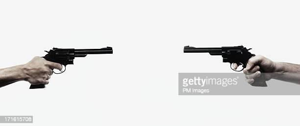 gun duel at close range - gun stock pictures, royalty-free photos & images