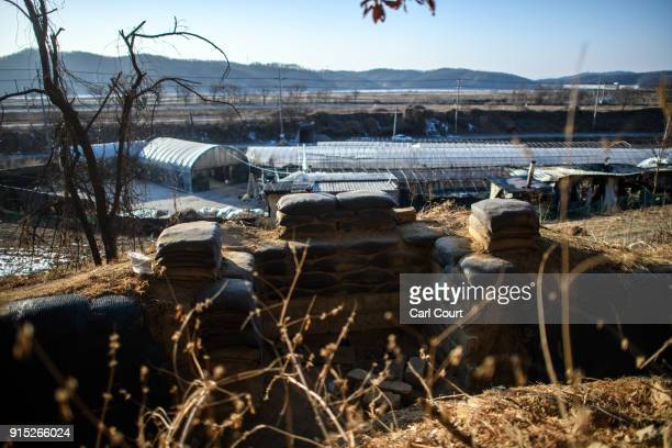 A gun emplacement in an operational trench system overlooks the main highway leading towards North Korea near the Demilitarized Zone on February 7...
