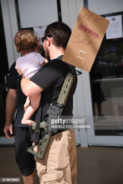 A gun enthusiast arrives at the South Florida Gun Show at Dade County Youth Fairgrounds in Miami Florida to sell his weapon on February 17 2018 The...