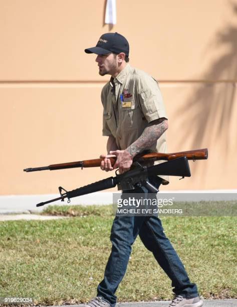 A gun enthusiast arrives at the South Florida Gun Show at Dade County Youth Fairgrounds in Miami Florida on February 17 2018 The gun show started...