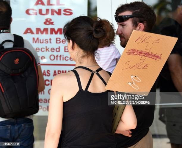 A gun enthusiast arrives at the South Florida Gun Show at Dade County Youth Fairgrounds in Miami Florida to sell her weapon on February 17 2018 The...