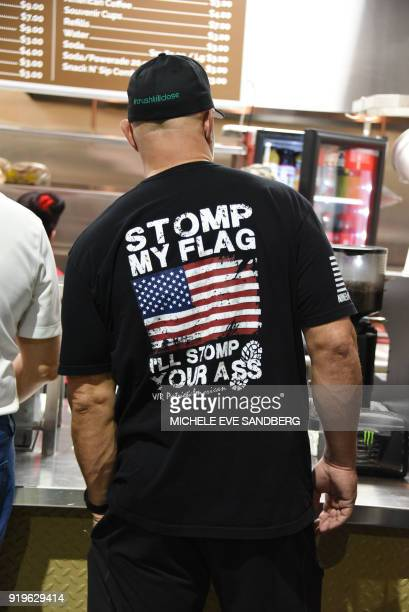 A gun enthusiast attends the South Florida Gun Show at Dade County Youth Fairgrounds in Miami Florida on February 17 2018 The gun show started three...