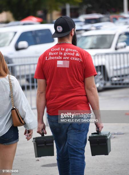 A gun enthusiast leaves the South Florida Gun Show at Dade County Youth Fairgrounds in Miami Florida on February 17 2018 The gun show started three...