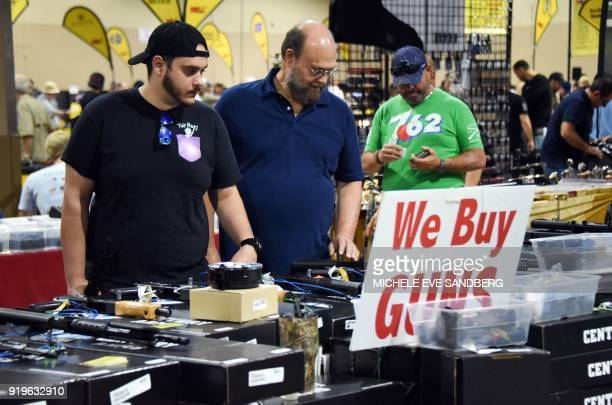 Gun enthusiasts attend the South Florida Gun Show at Dade County Youth Fairgrounds in Miami Florida on February 17 2018 The gun show started three...