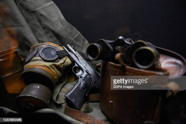 A gun gas mask and a binocular are seen during the exhibition Exhibition at Oskar Schindler's Enamel Factory museum it is primarily a story about...
