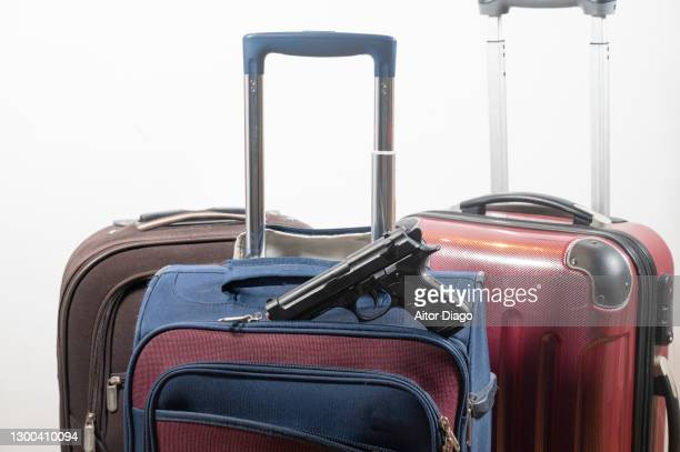 gun in a travel suitcase. - bootlegger stock pictures, royalty-free photos & images